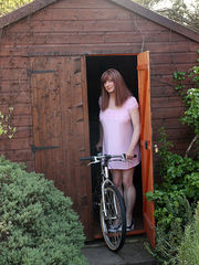 TGirl Luci takes her bike out for a spin, but ends up with her saddle up her ass and wanking in the garden